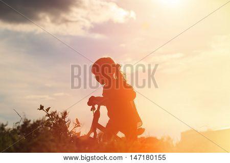 little girl riding bike at sunset sky, active kids
