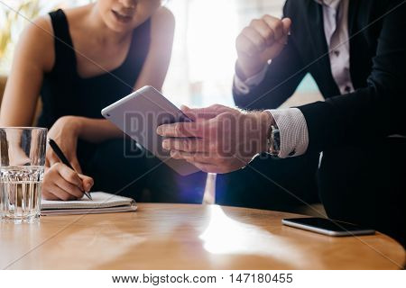 Business Colleagues Working Together In Office