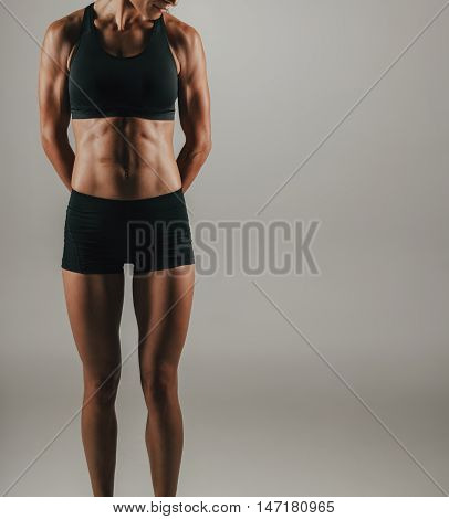 Fit Young Woman Flexing Her Abdominal Muscles