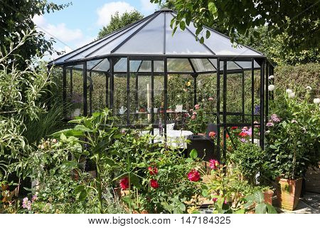 Gazebo in a garden with different flowers