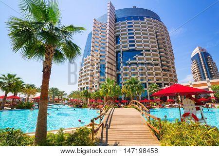 ABU DHABI, UAE - MARCH 28, 2014: Pool area of resort Khalidiya Palace by Rotana in Abu Dhabi, UAE. Rotana Hotel Management Corporation has 85 properties in 26 cities around Middle East and Africa.