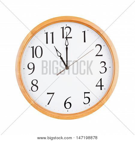 Exactly twelve o'clock on a large round dial