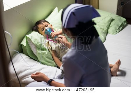Sick boy inhale edication on bed to cure Respiratory Syncytial Virus (RSV)