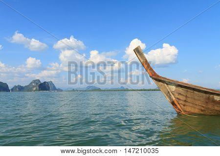 Long tail boat against blue sky and sea. Koh Rok island James Bond Island (Khao Phing Kan Ko Tapu) Phang Nga Bay Thailand