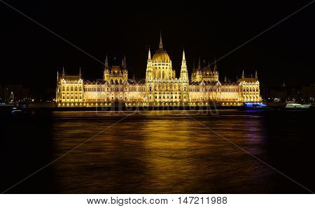 Budapest Parliament At Night Near The Danube River