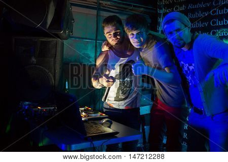 RUSSIA, MOSCOW - 21 DEC, 2015: Three Djs (with model releases) are standing together at Rublev club.