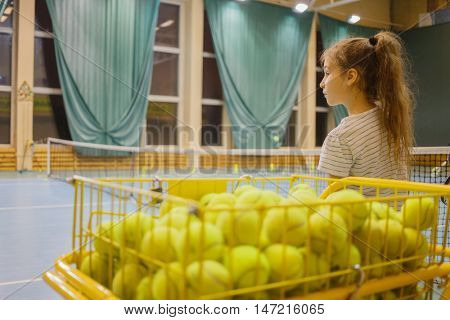 tennis balls in truck about girl tennis player on tennis court in sports hall