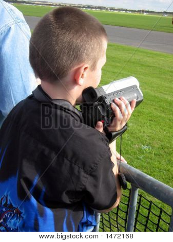 Young Photographer/Boy Carrying His Camera