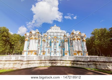 Hermitage Pavilion in Royal Catherine park located in Pushkin, Saint Petersburg. The building of Queen Catherine's Palace on sunny day. Russian royal tourist attractions.