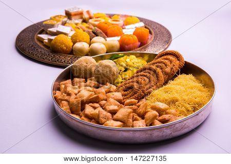 indian sweet food consumed in festivals like diwali, holi, dussehra, gudhi padwa or weddings poster