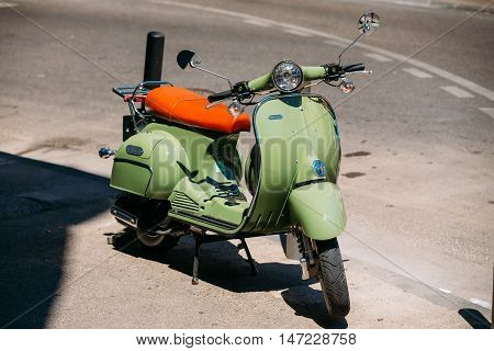 Marseille, France  - June 30, 2015: Green vintage sprint motor scooter motorbike motorcycle parked in city.