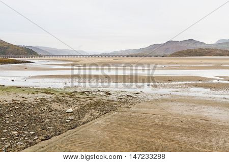 Estuary and railway viaduct. Mawddach Estuary Fairbourne Wales United Kingdom