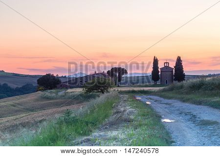 Tuscany landscape Crete Senesi little chapel and trees