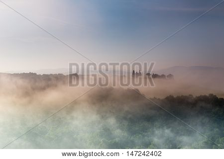 Beautiful morning foggy landscape in Tuscany, Italy