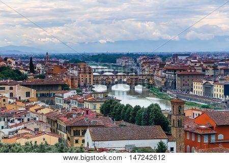 Florence Italy, Ponte Vecchio arch bridge over the Arno River