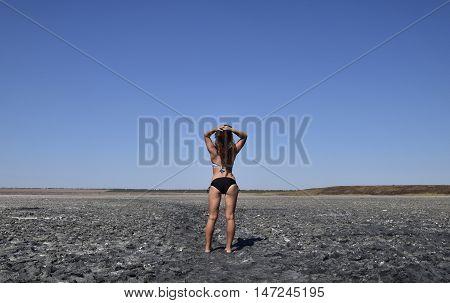 Girl Standing On The Dry Bottom Of A Salt Lake