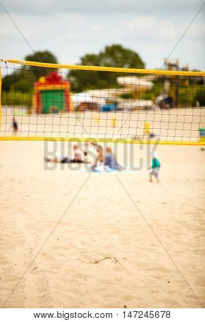 Volleyball summer sport equipment. Closeup of net netting wire on a sandy beach outdoor. Active lifestyle.
