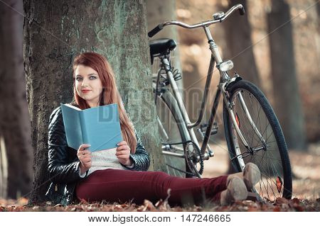 Woman Reading Book Under Tree