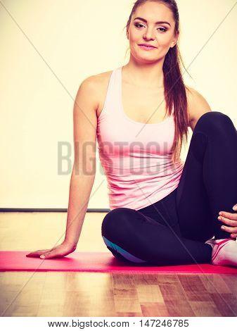 Gymnastic Girl Sitting On Matress.