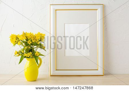 Frame mockup with small yellow flowers in stylized pitcher vase. Poster white frame mockup. Empty white frame mockup for presentation design.