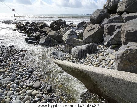 Rocky beach and river seascape photographed at Amroth in Pembrokeshire
