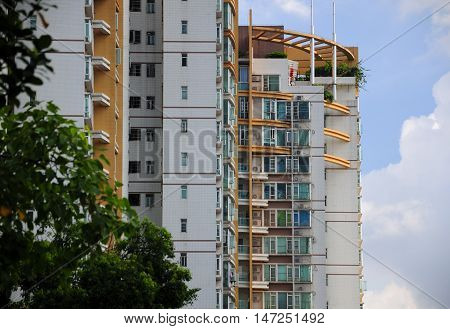 Apartment buildings against a blue sky within the city of Guangzhou China in Guangdong province.