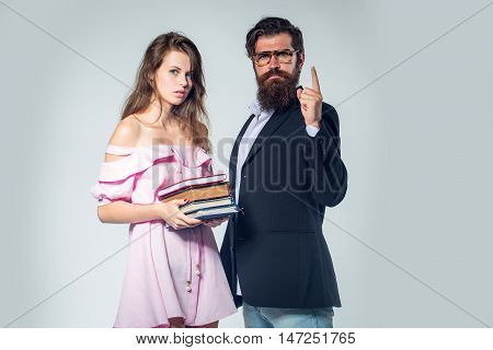 Young Couple With Books And Glasses