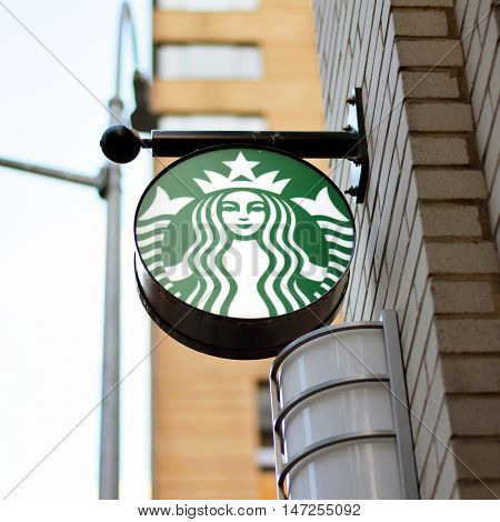 NEW YORK NY - SEPTEMBER 9th 2016: Starbucks sign hanging outside of location in Upper East Side Manhattan during daytime