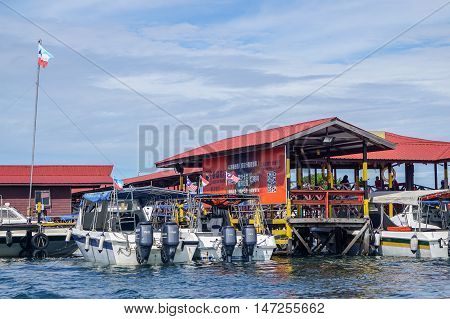 Semporna,Sabah-Sept 10,2016:Jetty of speedboats terminal in Semporna, Sabah, Borneo on 10th Sept 2016.Its a gateway for diving & snorkeling trips to the islands of Sipadan,Mabul, Mataking, Maiga & others