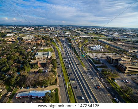 Aerial Austin Over Highway 183 on a nice sunny morning in Austin , Texas with interchange and loops in the distance and cars driving during traffic rush hour