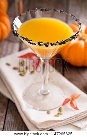 Pumpkin martini fall seasonal cocktail Pumpkintini with black salt rim