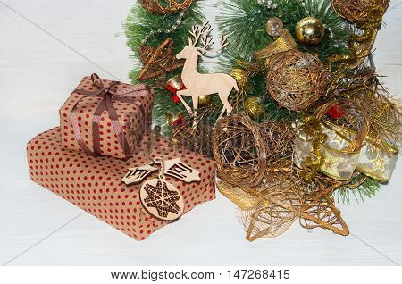 Christmas Gifts Wrapped In Paper With Christmas Decorations And Wooden Toys.
