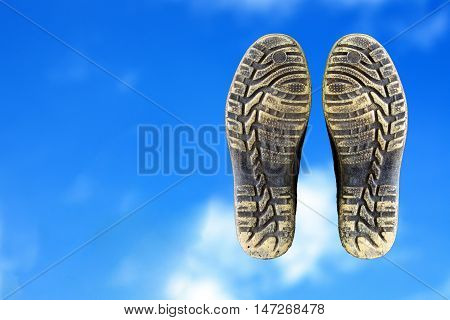 boots on sky, concept of walking above