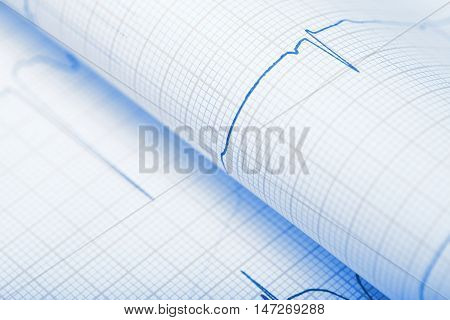 Bended paper sheet with ECG record. Close-up photo