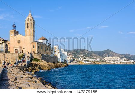 SITGES, SPAIN - MARCH 15, 2015: The view of Sant Bartomeu Church in the picturesque seaside village of Sitges Catalonia Spain