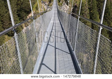 Holzgau Suspension Bridge in Lech Valley. Tirol. Austria