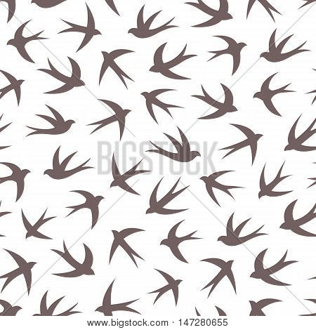 Seamless pattern with a flock of swallows. Vintage background of silhouettes of birds in the sky. Vector illustration.