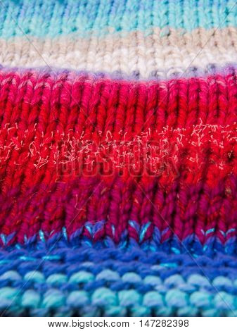 striped colorful wool texture handmade patten closeup macro blue red white biege