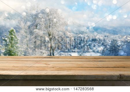 Background with wooden table over winter lanscape