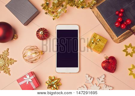 Smartphone with Christmas decorations. Christmas mock up template. View from above