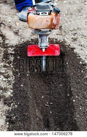 Farmer Plows Garden Ground By Tiller