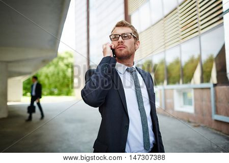 Businessman caling outdoors