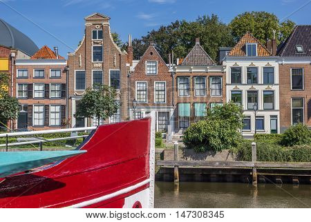 Bow of a red ship and historical houses in Zwolle Netherlands