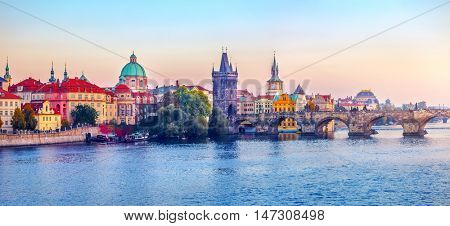 Sunset landscape view to Charles bridge on Vltava river in Prague Czech republic