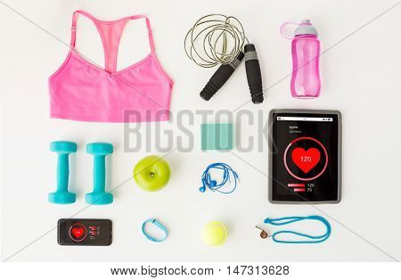 sport, fitness, healthy lifestyle, technology and objects concept - close up of tablet pc computer and smartphone with heart rate on screens and sports stuff over white background