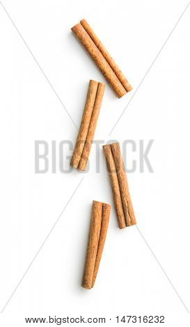 Cinnamon sticks spice isolated on white background. Top view.