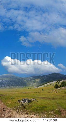 Dinara Mountain Over Blue Sky 1