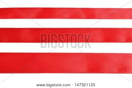 Three samples of red cloth tape isolated