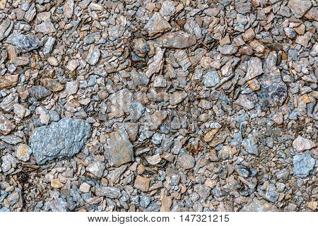 Abstract natural building background with gray small stones in the form of rubble