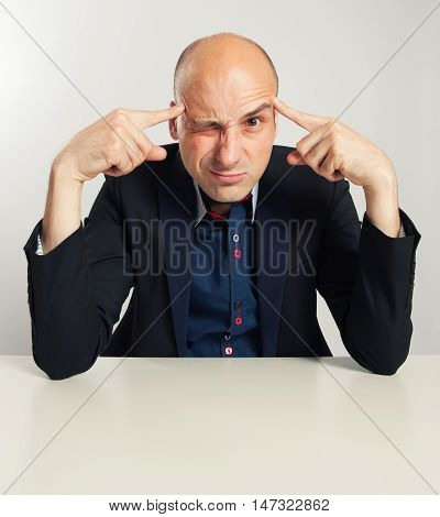 Funny Bald Businessman Trying To Think Seriously
